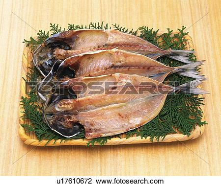 Stock Photo of Horse Mackerel cut open and dried, high angle view.