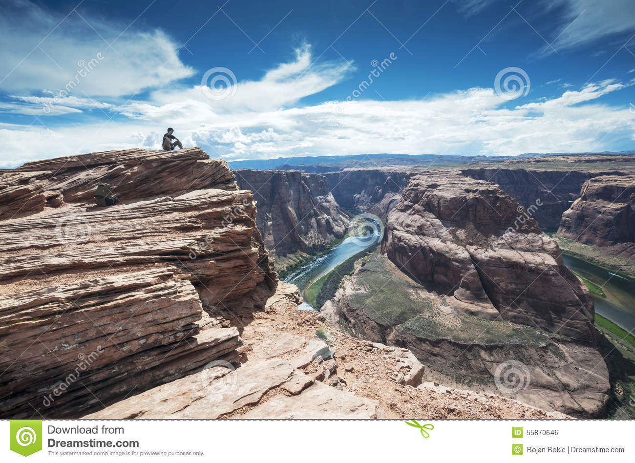 Sitting On The Top Of The Horseshoe Bend On Colorado River Stock.