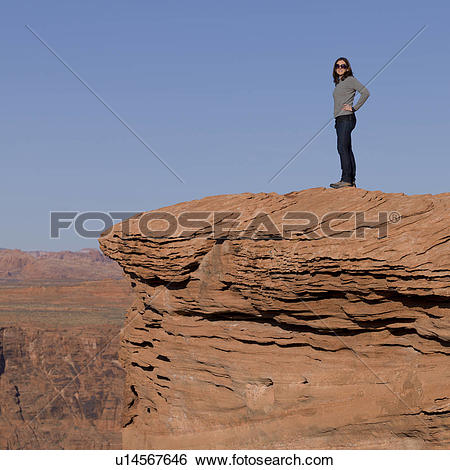 Stock Images of Woman standing on a rock at Horseshoe Bend, Glen.