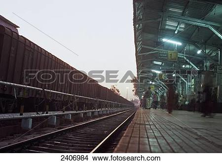 Stock Photo of People waiting at railway platform, Hospet.