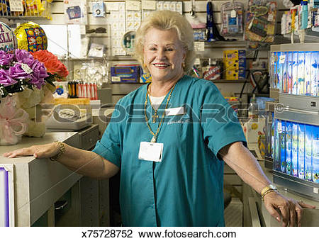 Stock Photo of Hospital employee working at gift shop x75728752.