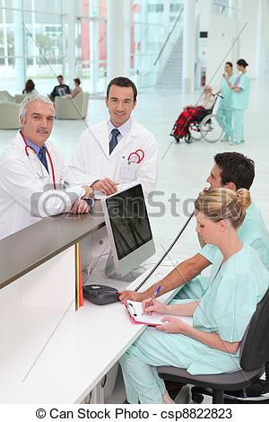 Stock Photos of Staff at hospital reception csp8822823.