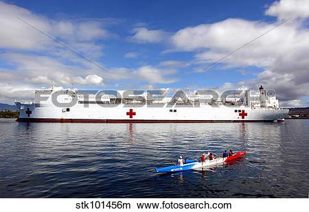 Stock Photo of The Honolulu Pearl Canoe Club escorts the Military.