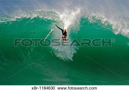 Stock Photography of Australia's Mick Fanning wipes out on a wave.