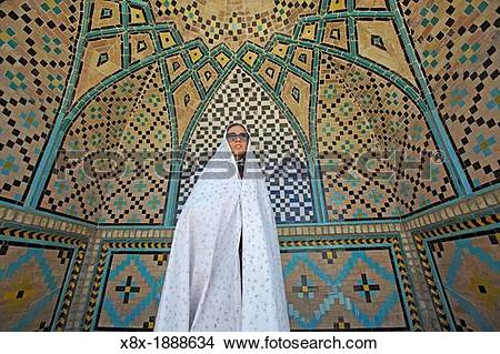 Stock Photo of Woman at Imamzadeh Hossein Mausoleum, Qazvin, Iran.