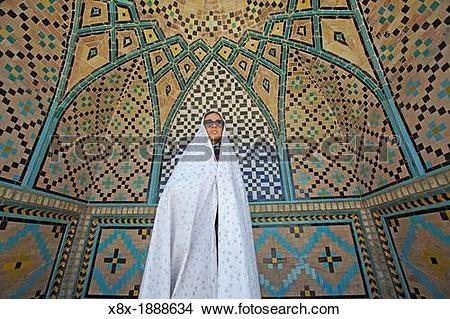 Stock Photo of Woman at Imamzadeh Hossein Mausoleum, Qazvin, Iran.