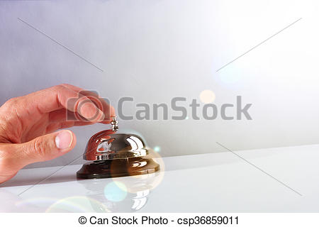 Stock Photography of Customer ringing the bell hotel service front.