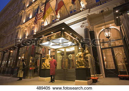 Stock Image of Guard standing at entrance of hotel, Sacher Hotel.