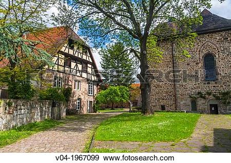 Stock Photograph of Timbered house and the medieval monastery of.