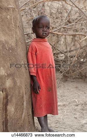 Stock Photo of Small Masai child wearing long red T.