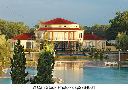 Stock Photo of Big summer house with swimming pool in summer.