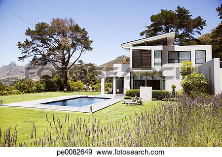 Stock Photograph of Modern house with swimming pool pe0082649.