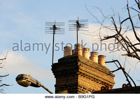 black silhouette of house with chimney in white background Stock.