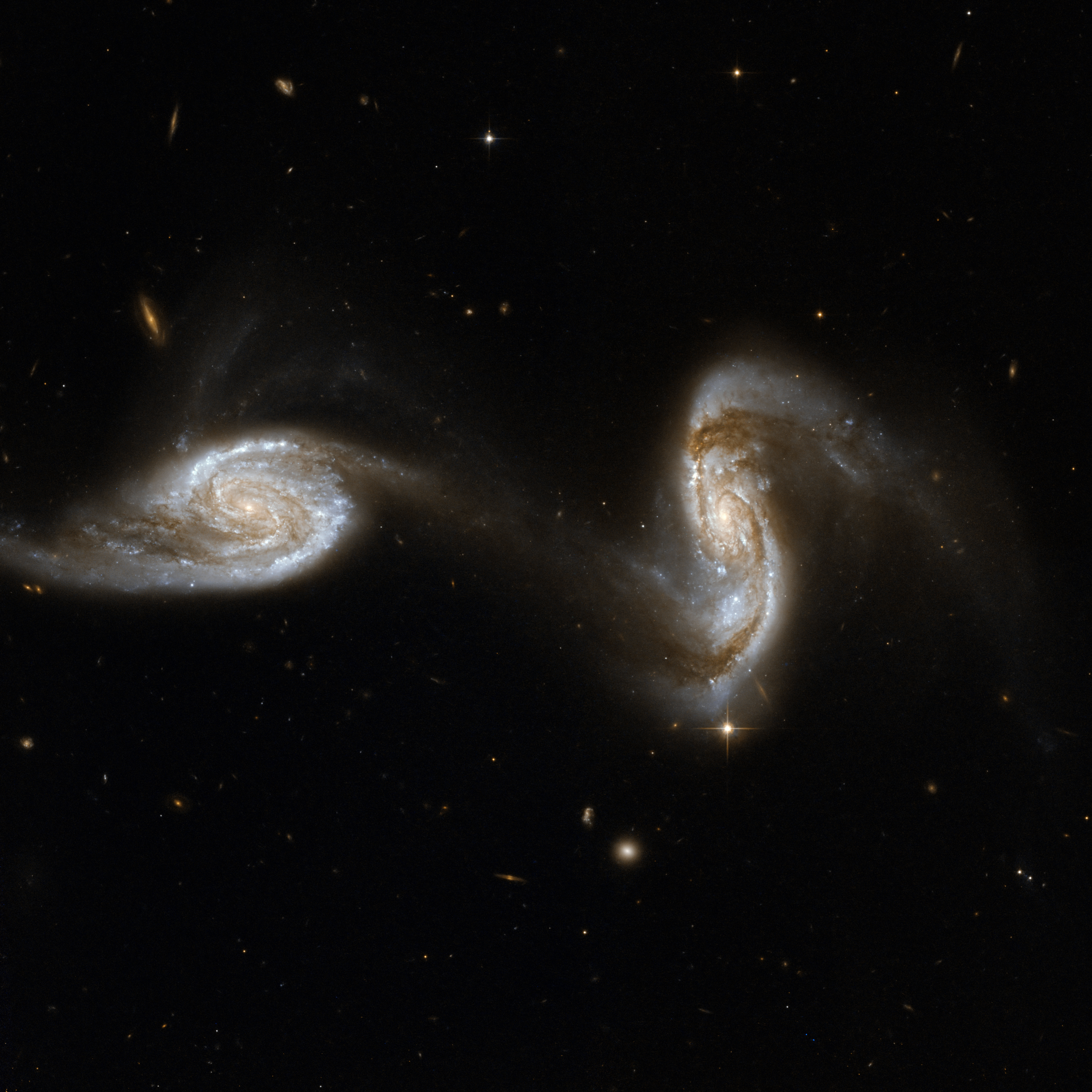HEIC: Inseparable Galactic Twins (MRK 1034).