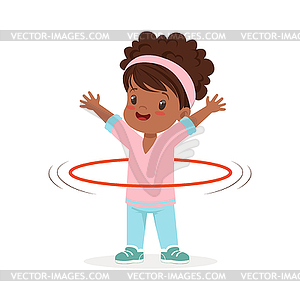 Girl spining hula hoop around waist, kid doing.