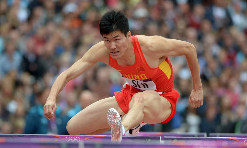 Report: Chinese hurdler was vomited on and robbed during first day.
