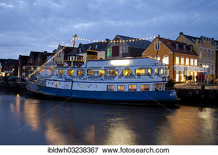 "Picture of ""Port of Husum with a boat restaurant during the blue."