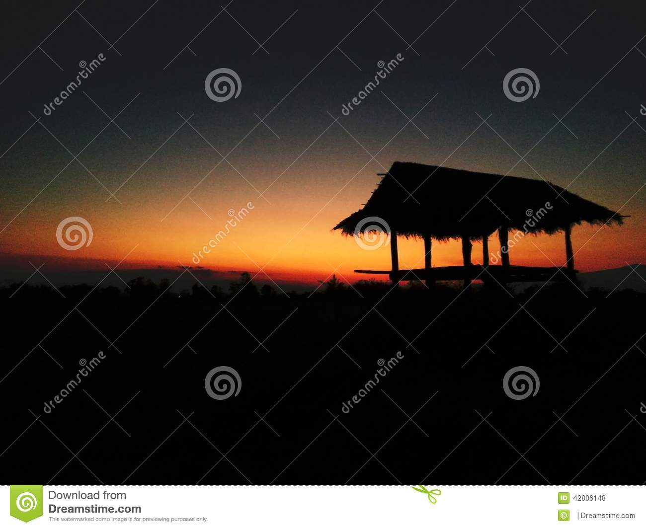 Hut In Evening Before Sunset Stock Photo.