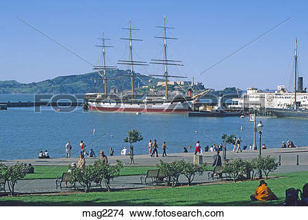 Stock Photo of people relaxing at Aquatic Park with tall ship.