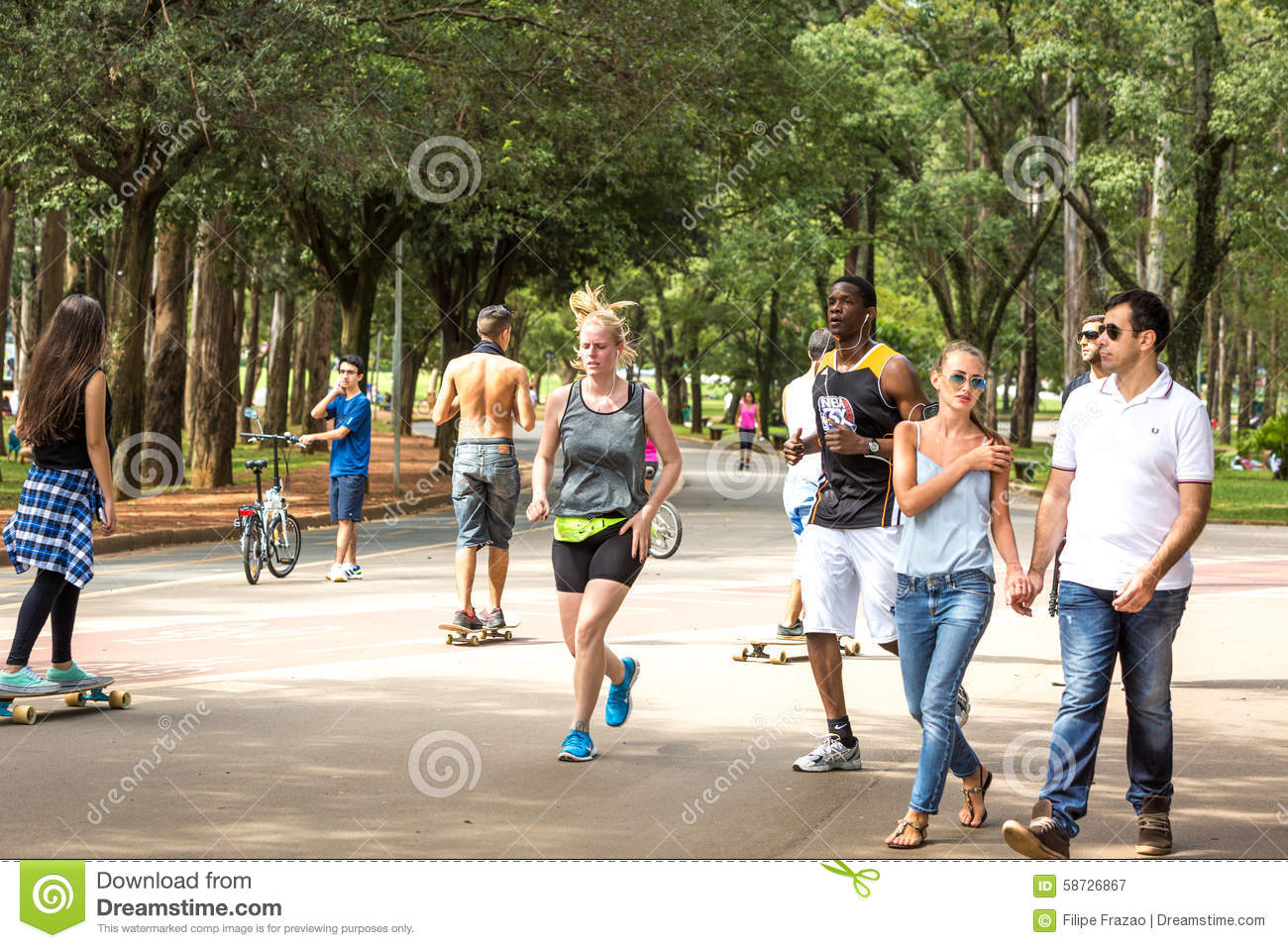 People Enjoy A Hot Day In Ibirapuera Park In Sao Paulo, Brazil.