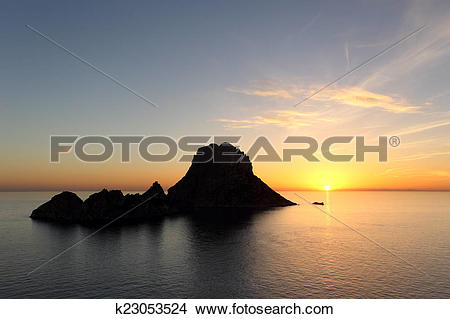 Stock Photo of Sunset on Es Vedra in Ibiza island k23053524.