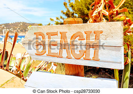 Stock Photos of signpost pointing to the beach in Ibiza Island.