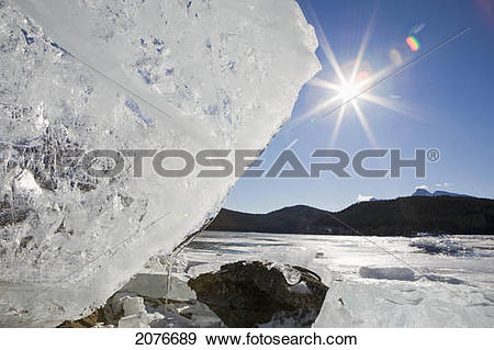 Stock Photograph of Ice formation on shoreline of a mountain lake.