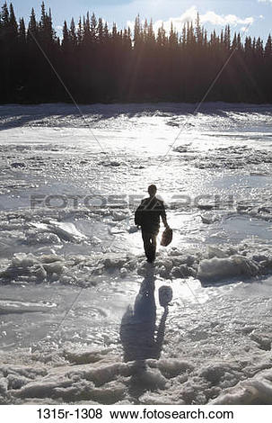 Pictures of Canada, Alberta, businessman crossing ice jam on.