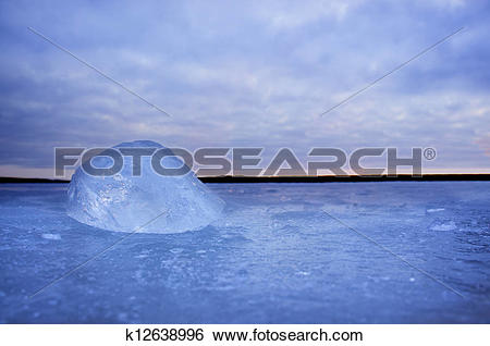 Stock Images of lump of ice on frozen lake k12638996.