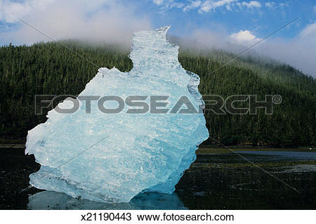 Stock Photo of Lump of ice in foreground, mist over woods.