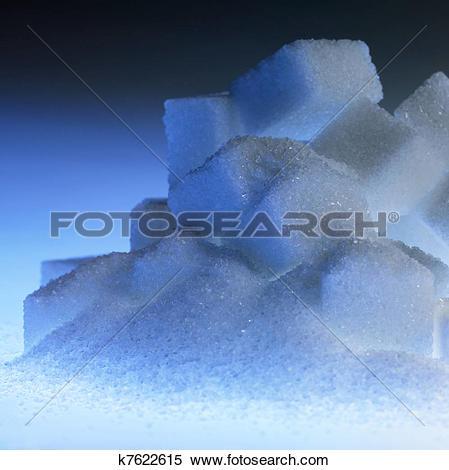 Stock Image of blue illuminated lump sugar pile k7622615.