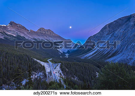 Stock Images of Moon over Icefields Parkway in Alberta, Canada.