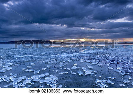 """Stock Photo of """"Chunks of ice lying on icy surface on the shore of."""