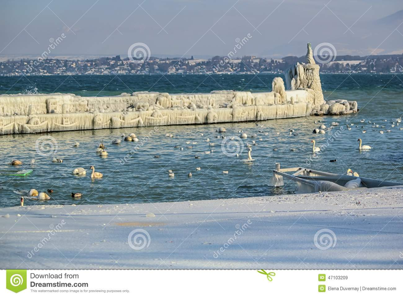 Frozen Jetty And Lighthouse At Versoix, Geneva, Stock Photo.