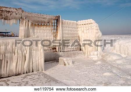 Stock Photo of Icy pier, frozen Black Sea, a rare phenomenon, last.