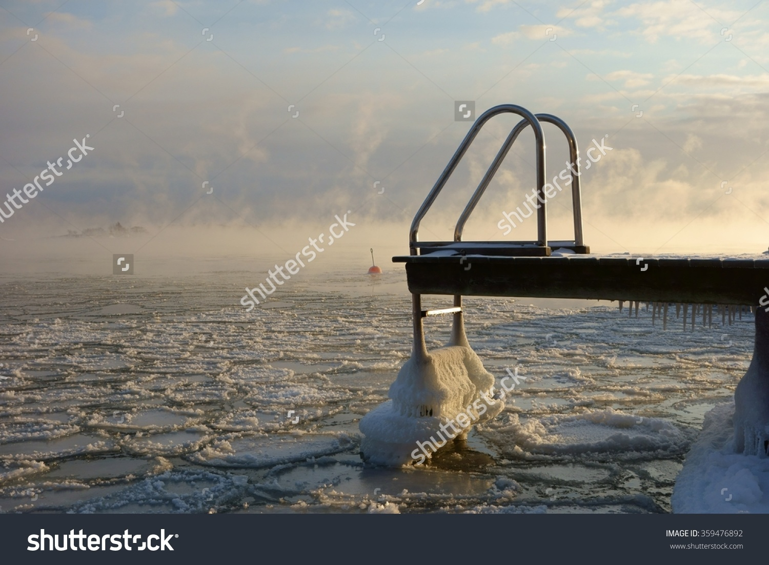 Ice Covered Swimming Jetty And Buoy In The Freezing Baltic Sea In.