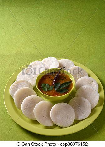 Idli with Sambar in bowl on green background, Indian Dish : south Indian  favourite food rava idli or semolina idly or rava idly, served with sambar.