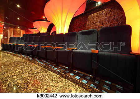Stock Photo of illuminated hall inside of ship. row of comfortable.