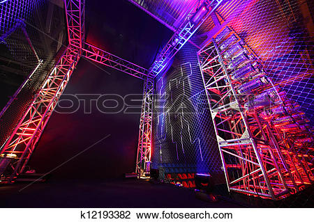 Stock Photo of Colorful illuminated way with grid to boxing ring.