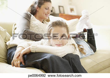 Stock Photo of Girl laying in mother's lap pe0064992.