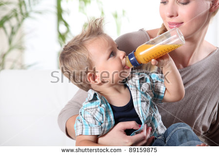 Child Drinking Juice His Mothers Lap Stock Photo 89159875.