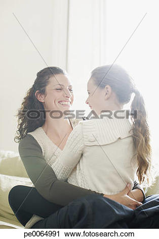 Stock Photography of Girl sitting in mother's lap pe0064991.