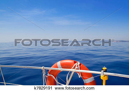 Stock Photography of boat in Ibiza with round red lifesaver buoy.