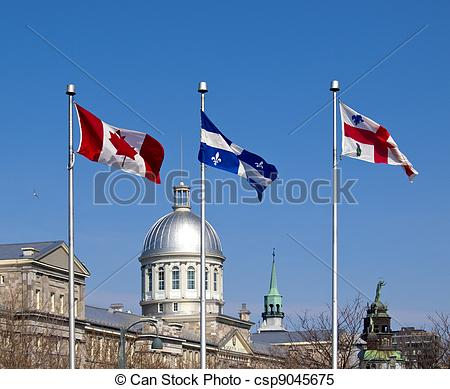 Stock Images of Flags of Canada, Quebec and Montreal in Old Port.