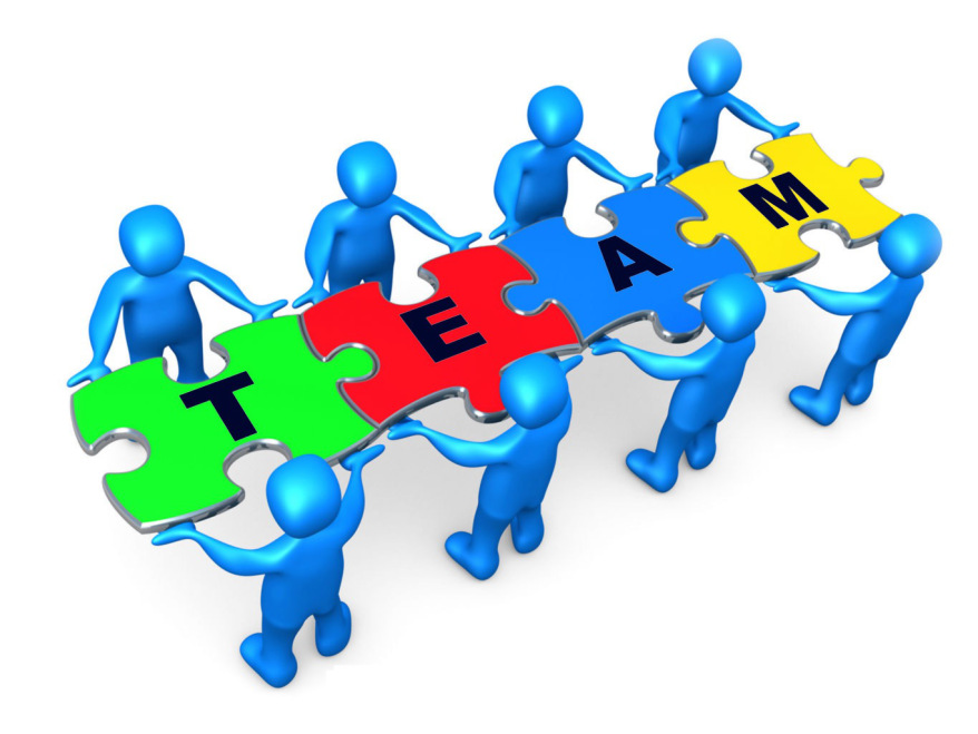 Team Of 8 Blue People Holding Up Connected Pieces To A Colorful.