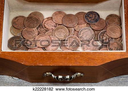 Stock Photo of Oak antique dresser drawer filled with old Indian.