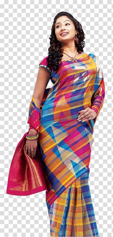Smiling woman wearing multicolored sari dress standing.