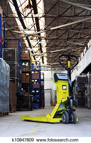 Stock Photograph of pallet jack in the industrial hall k10847809.