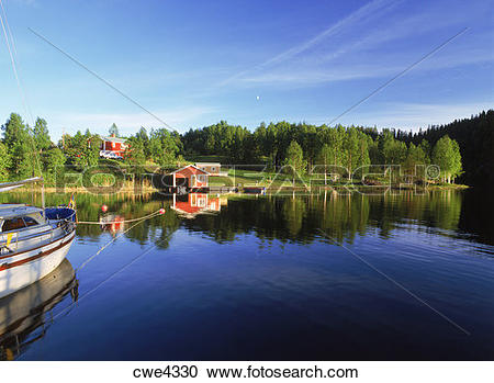 Stock Photography of Red country houses along inland waterways on.