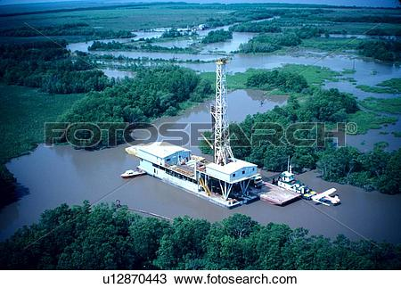 Stock Photo of Inland Water Oil Drilling Barge u12870443.